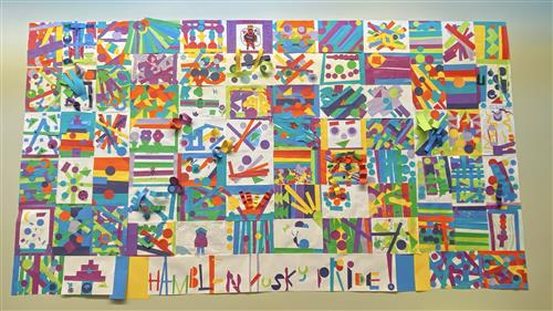 Colorful artwork made of construction paper hangs on the entry wall at Hamblen Elementary