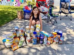 camryn with food donations