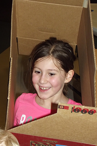girl playing in a box