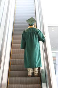grad on escalator