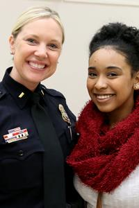 student and police officer smiling