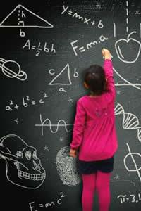 girl doing math on a chalkboard