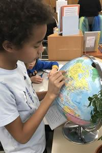 student looks at a globe
