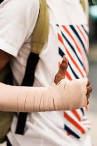 arm in ace bandage giving thumbs up sign