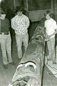 black and white photo of 1973 students working on totem pole