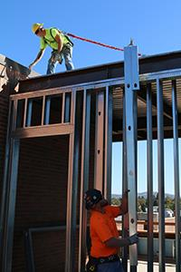 construction workers with metal framing