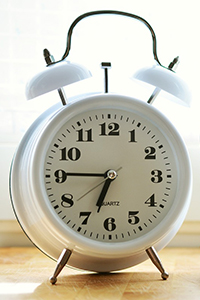 white alarm clock with bells